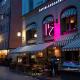 Österlånggatan 17 flaggskylt på restaurangmur av FocusNeo